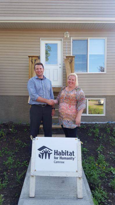 PF Cindy and her children, Kassidey and Rylea, receive keys to their new home on 42 St.