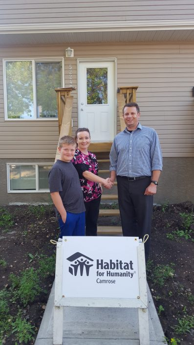 Partner Family Nikki and her son Carson receive keys to their new home on 42 St.